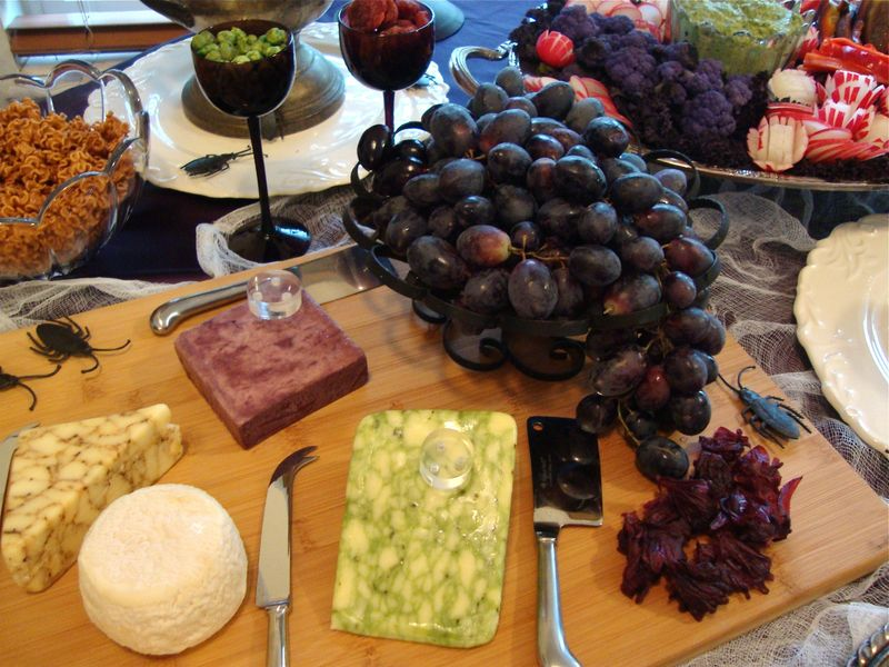 Halloween fruit and cheese plate, black grapes, cabarnet soaked cheddar, sage derby, goat cheese, Beecher's