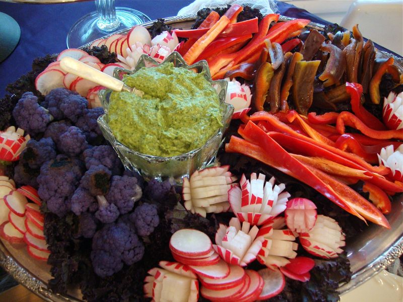 Halloween Crudite Platter, radish roses, purple cauliflower, red and purple bell peppers, cilantro hummus