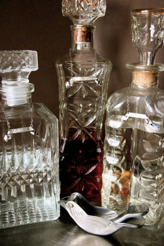 vintage crystal decanters with silver tags