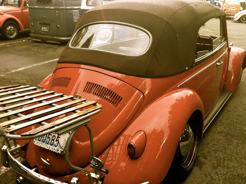 vintage red VW bug, convertible with rear luggage rack