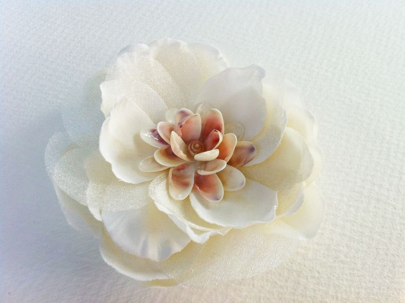 Gorgeous magnolia wedding flower with a vintage sea shell focal piece...perfect for a beach wedding!