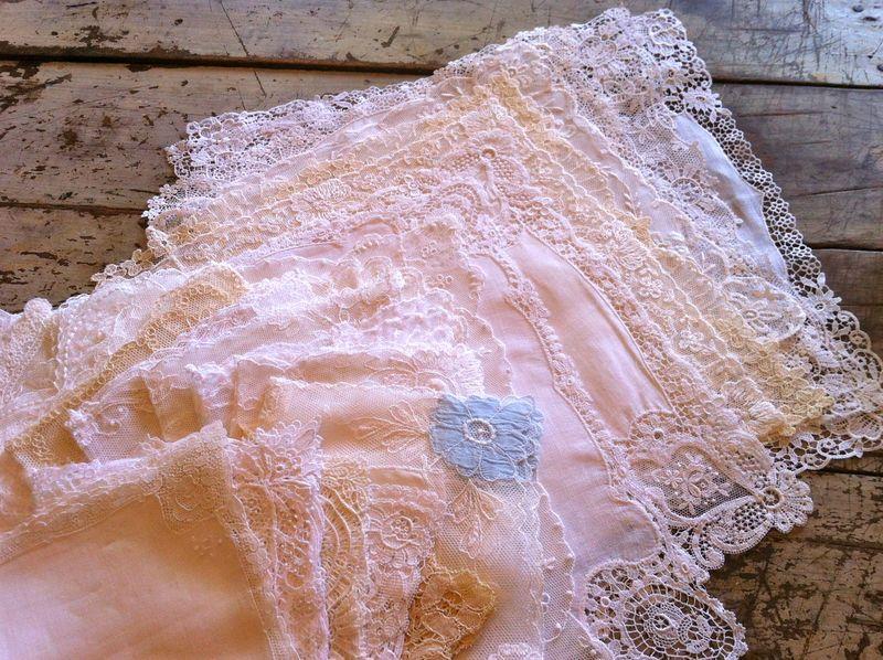 Piles of vintage lace wedding hankies.