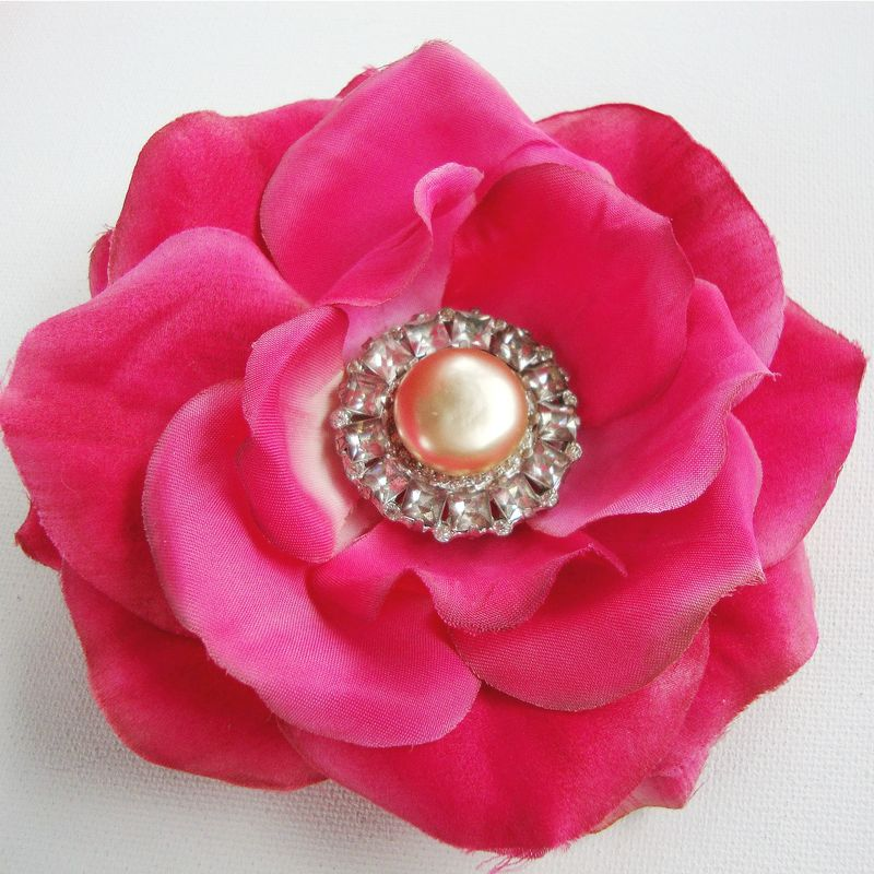 Hot pink rose hair clip featuring a vintage pearl and rhinestone cloak button in the center.