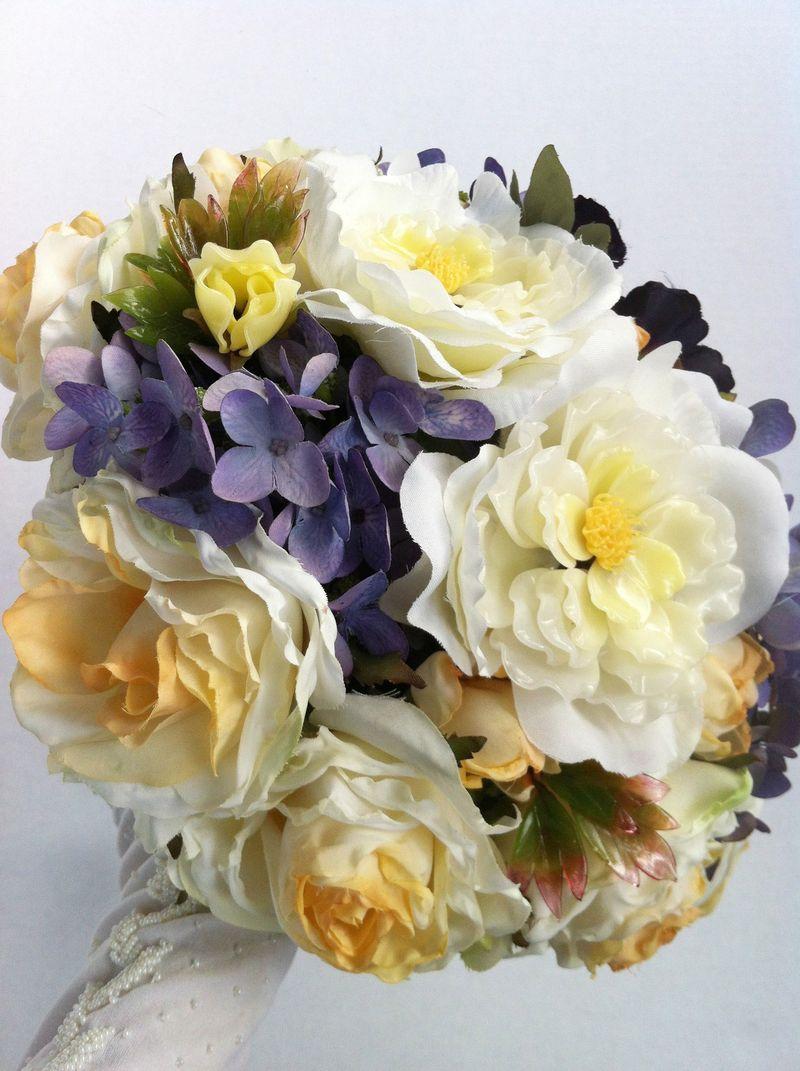 Purple and gold bridal bouquet featuring vintage glass bonsai flowers.