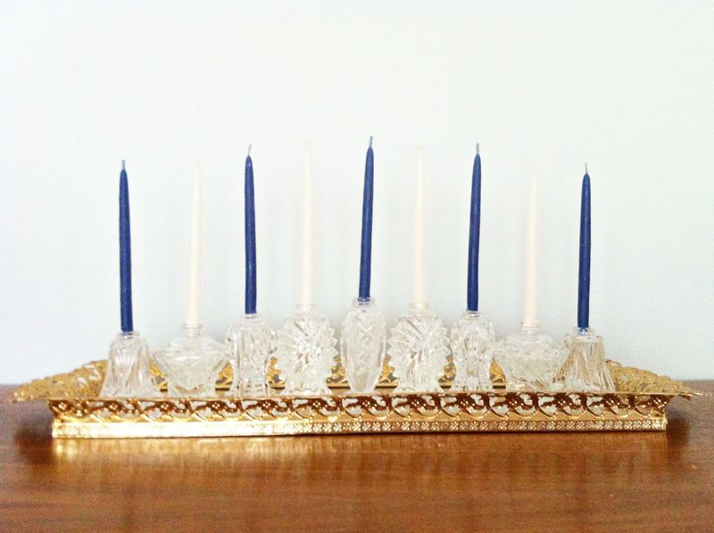 Elegant crystal menorah made from repurposed salt shakers.