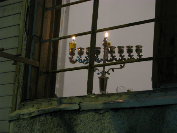 Menorah in window.
