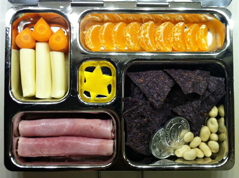 Cute bento style Hanukkah lunch...mozarella candles are too cute!