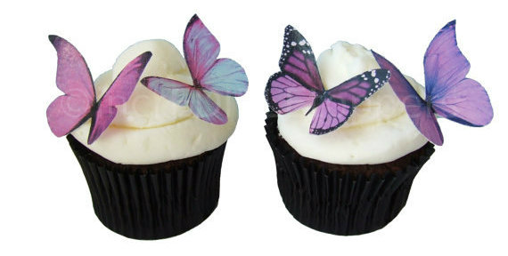 How sweet!  Delicate edible butterflies perched on cupcakes...