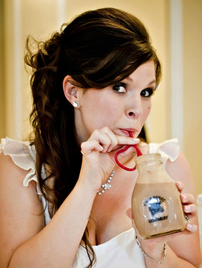 Adorable bride sipping chocolate milk from a red heart shaped straw...love!  Photo by Blue Wing Photos | http://bluewingphotos.com/