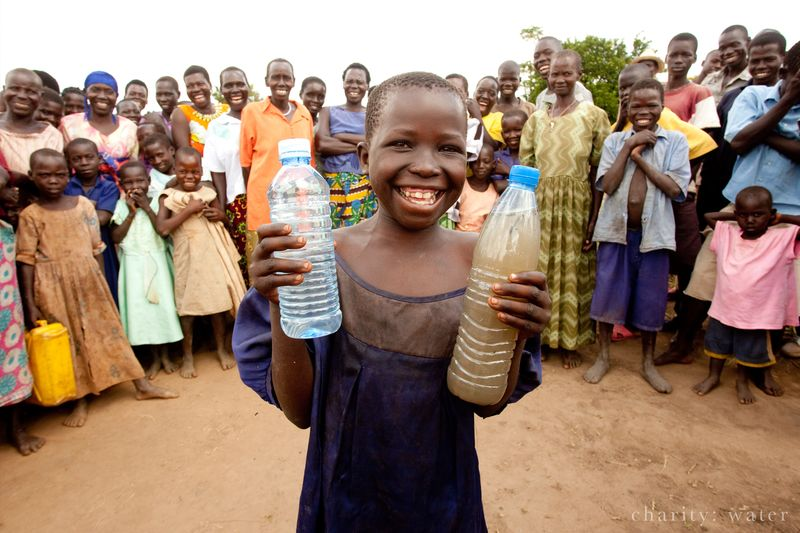 A girl in Uganda shows bottles of water before and after Charity: Water provided a fresh water source.