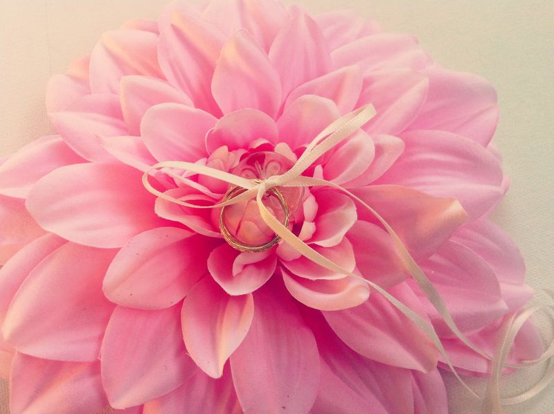 Adorable ring pillow alternative...giant dahlia flower instead of a pillow.  #wedding