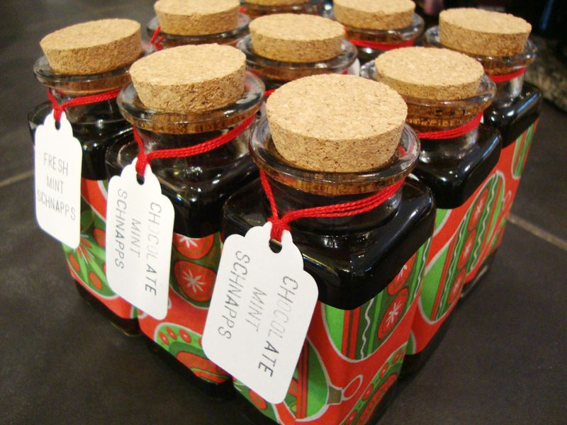Individual bottles of homemade peppermint schnapps for holiday gifts.