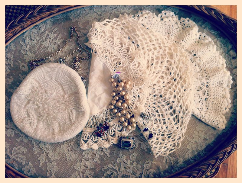Thrifty finds...vintage beaded purse, doilies and vintage jewels.
