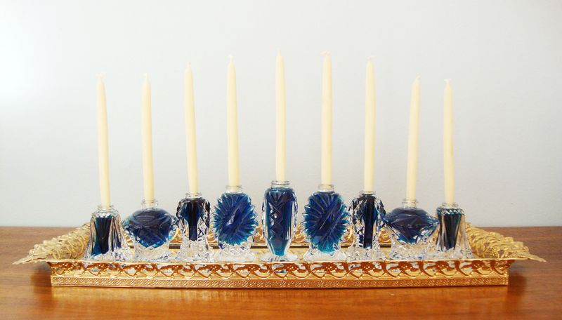 Hanukkah menorah made from repurpsed salt shakers filled with blue water...so pretty!