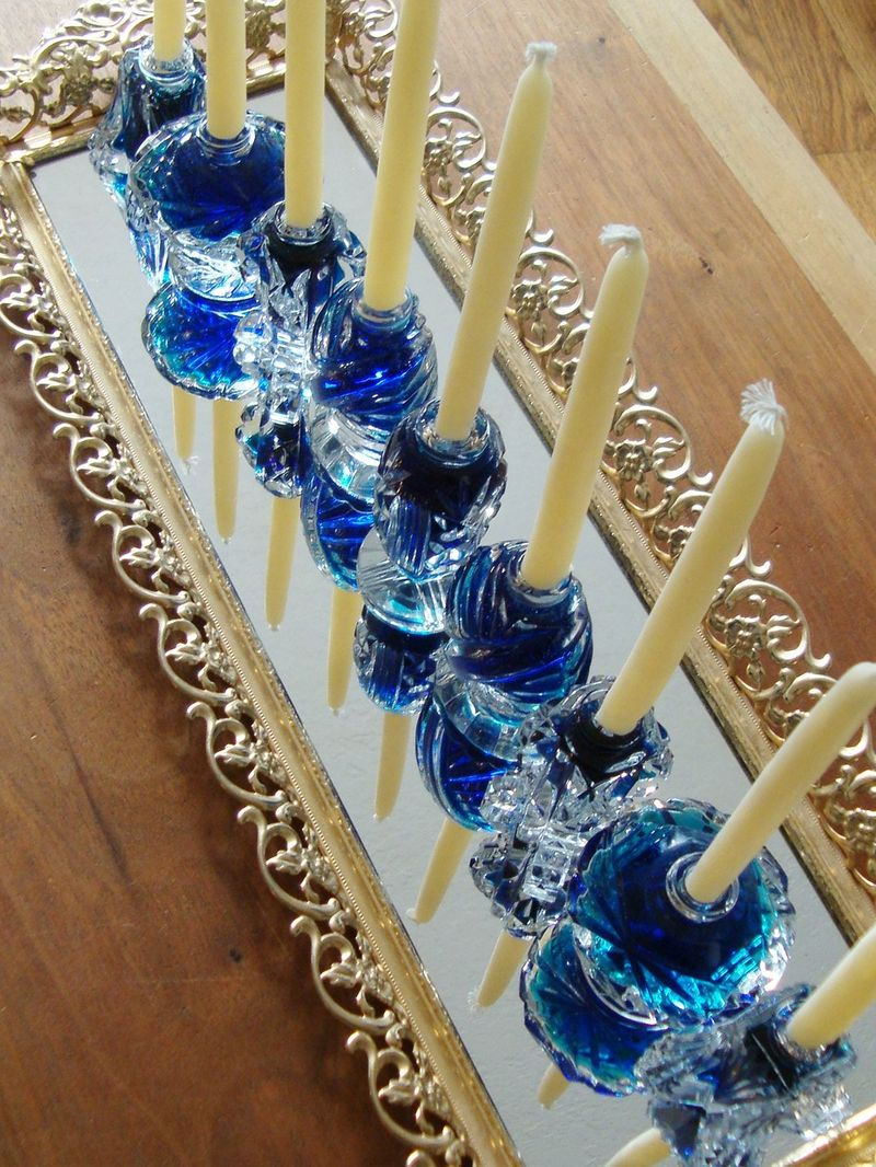 Love how the light shines through this DIY menorah made from vintage salt shakers.