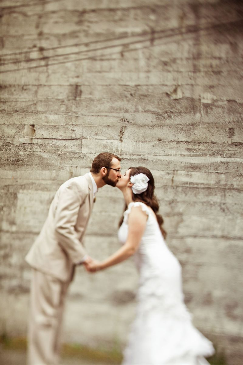 Cute bride and groom shot...love gritty wall behind them. Photo by Kaylee Eylander |  http://eylanderphotography.com/