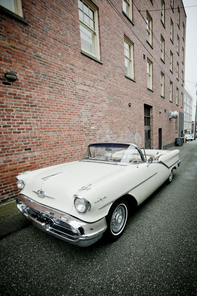 Smokin' hot vintage wedding getaway car!  Photo by Blue Wing Photos | http://bluewingphotos.com/