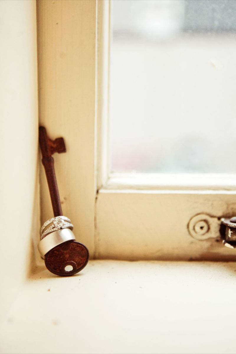 Love this wedding ring shot...cute idea to use a key.  Photo by Kaylee Eylander | http://eylanderphotography.com/