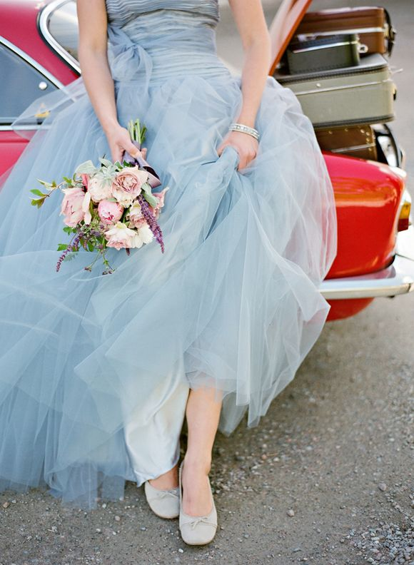 Blue tulle wedding dress, red sportscar, trunk full of vintage luggage...let's go!
