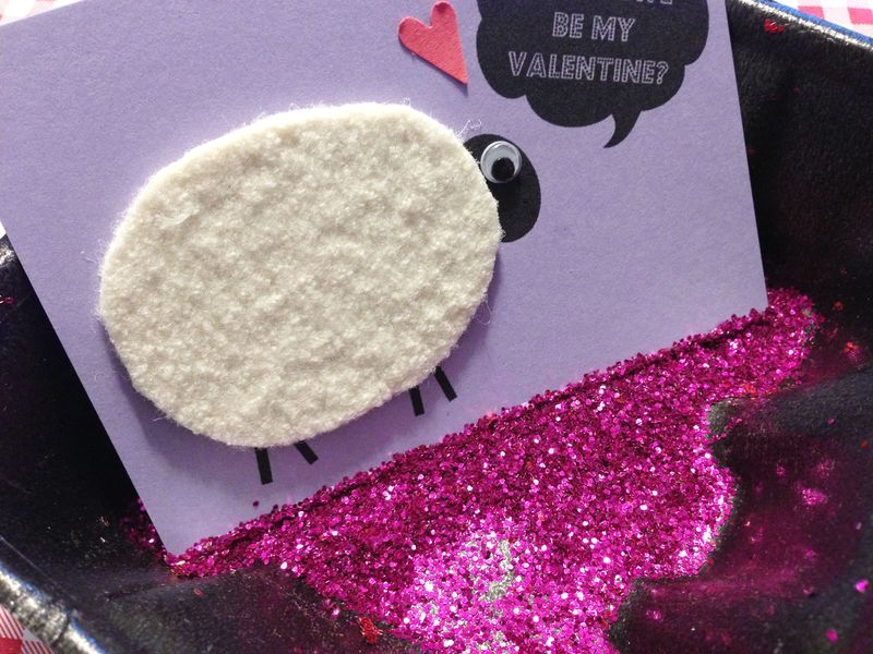 Glittering the edges of a card...dip in glue first, then glitter.