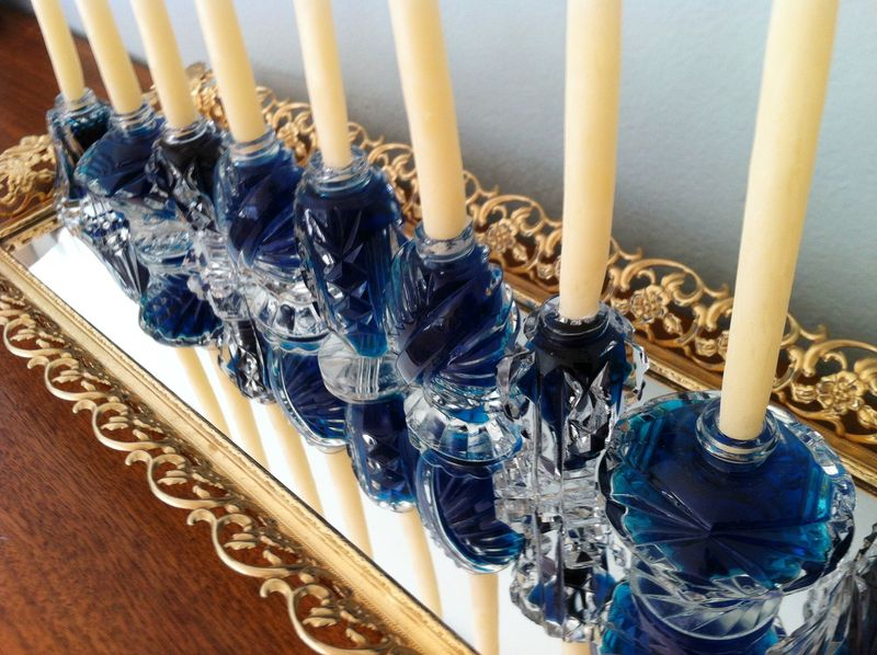 Great idea to put your Hanukkah menorh on a mirrored tray to reflect the candle light.