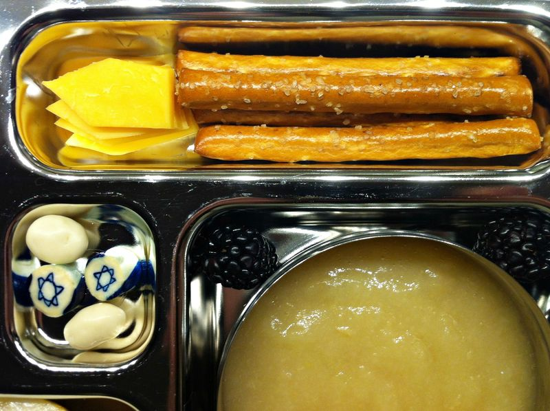 Hanukkah bento lunch...love the pretzle rod candles!