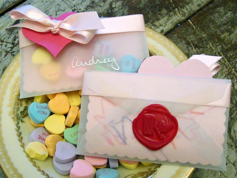 Sweet little pocket Valentines with candy hearts and a wax seal.