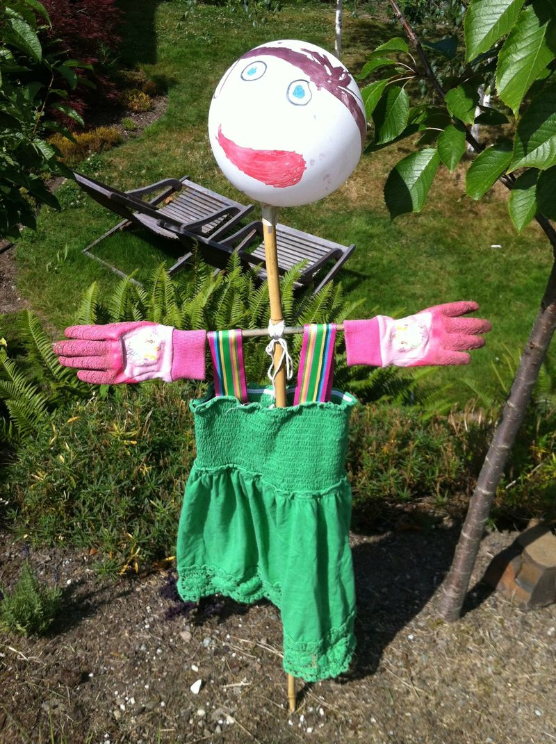 Funny balloon head scarecrow.