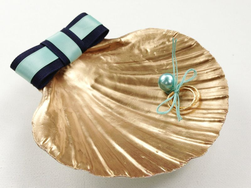 Gilded ring bearer scallop shell...fun alternative to a pillow.